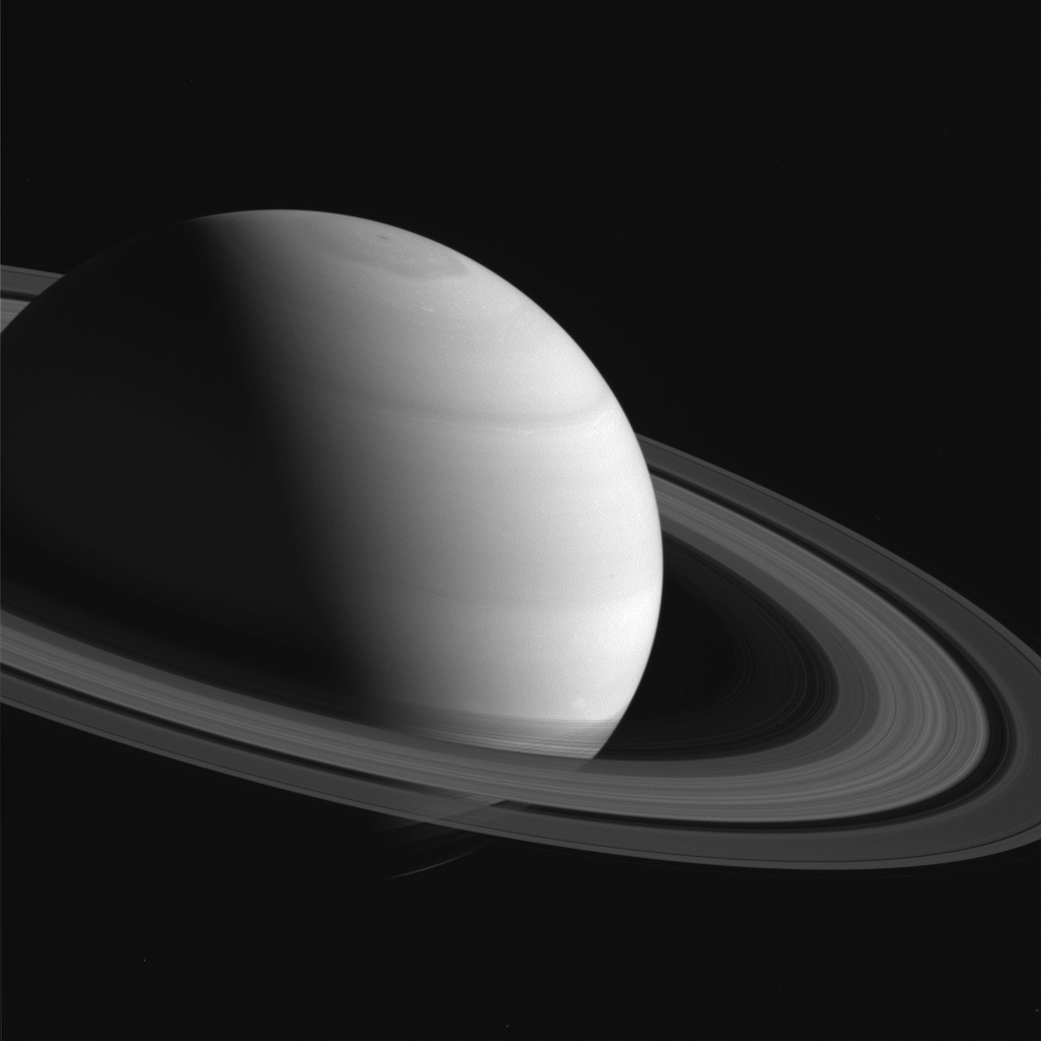 A close-up view of Saturn with rings shadowing the planet's southern hemisphere