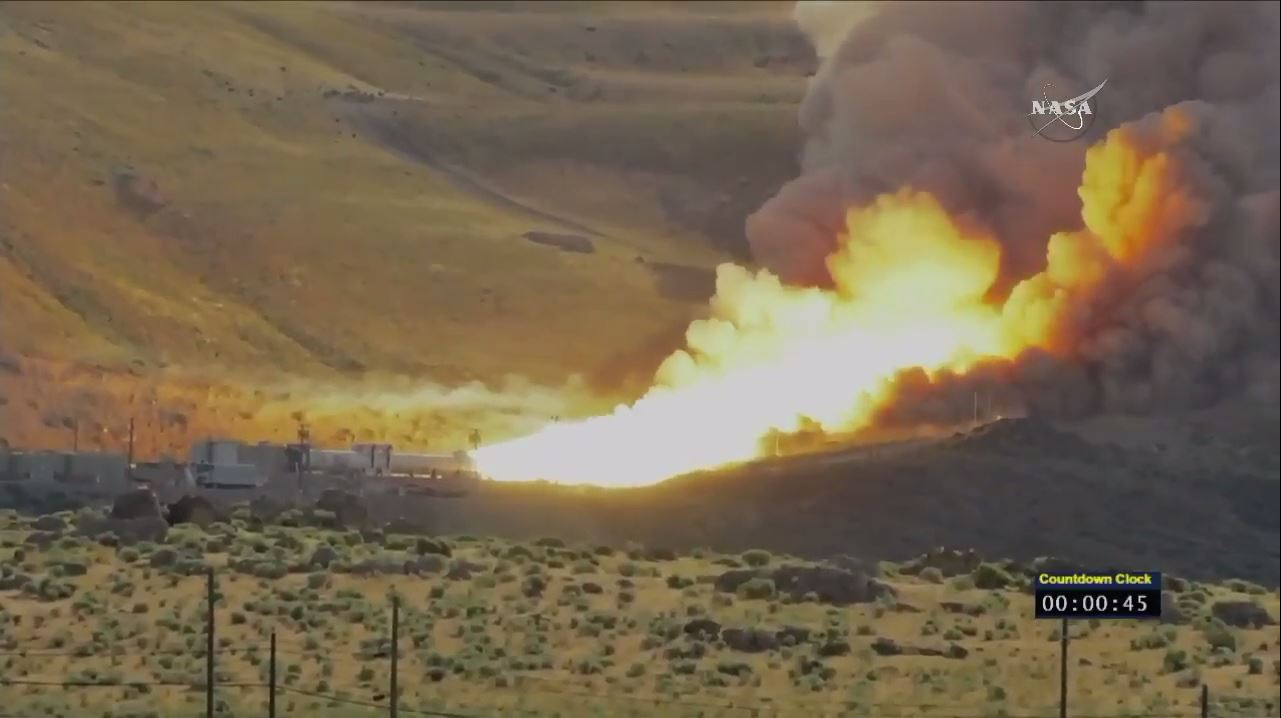 A view of the fire and smoke emerging from NASA's SLS rocket booster engine, which underwent a test firing on June 28, 2016.