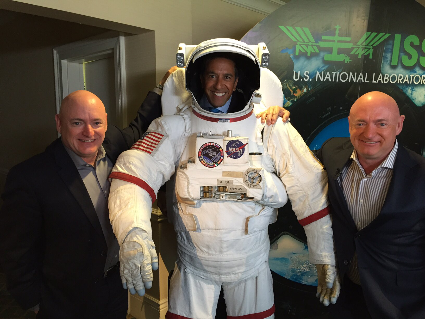 Scott Kelly, Mark Kelly and Sanjay Gupta