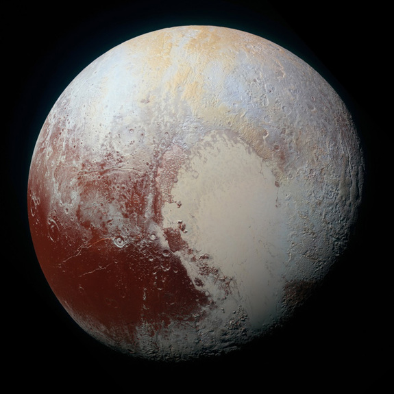 "This enhanced-color picture of Pluto, taken by NASA's New Horizons examine during a ancestral flyby on Jul 14, 2015, shows a dwarf planet's famous ""heart."""