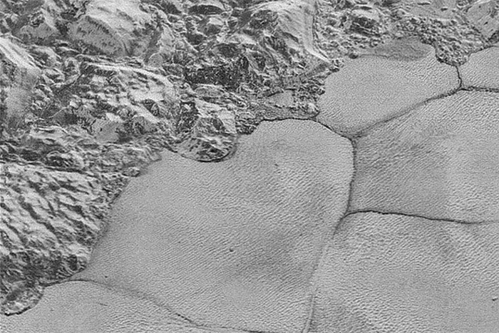 Pluto's Mountains Meet the Vast Plain