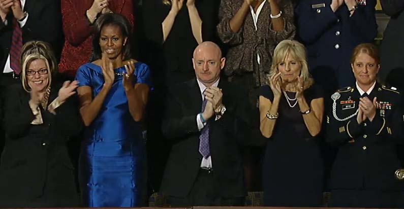 Former NASA astronaut Mark Kelly applauds President Barack Obama after the 2012 State of the Union address. Kelly will speak during the 2016 Democratic National Convention in Philadelphia on July 27, 2016.