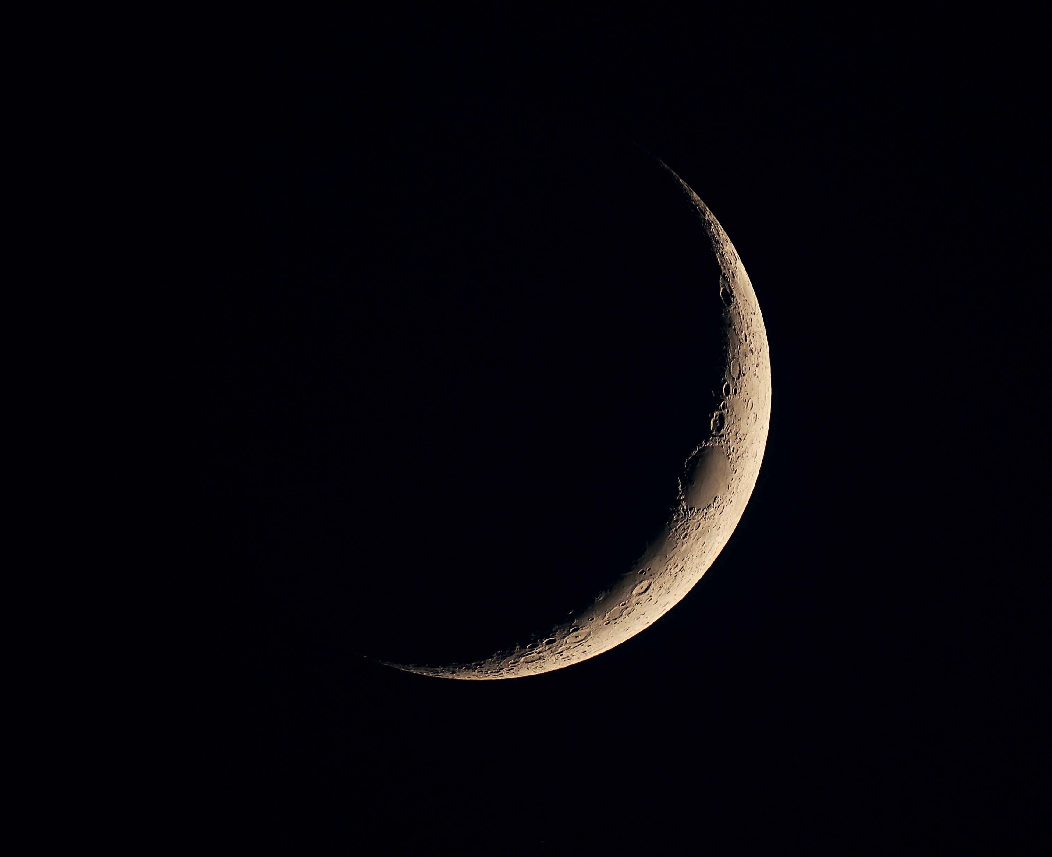 Very thin crescent moon in black sky