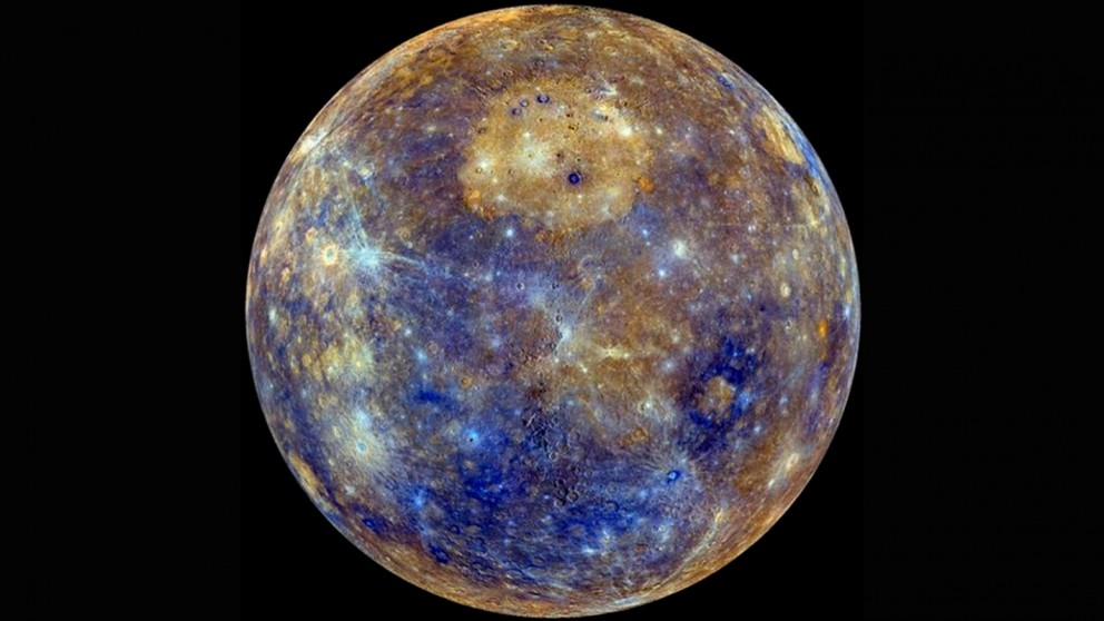 Mercury has several craters scattered across its surface. The Caloris basin — one of the planet's largest craters — is the bright, circular deposit seen in the upper center of this image. Within this crater lies an enormous, effusive volcanic deposit that