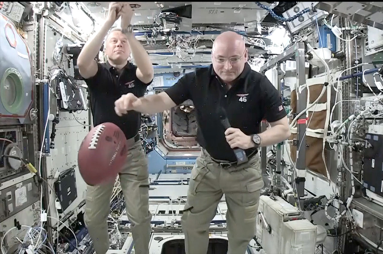 Astronaut Scott Kelly and super bowl football