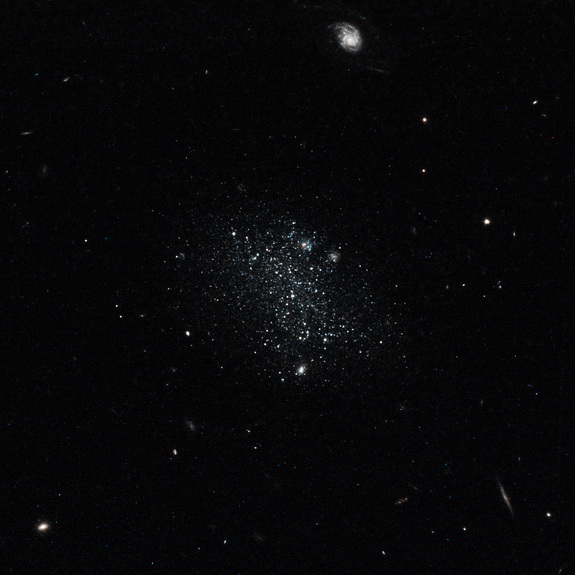 This color composite taken on Oct. 30, 2014 by the Hubble Space Telescope shows what the dwarf galaxy Pisces A would look like to the naked eye: a dim cluster of light blue stars.