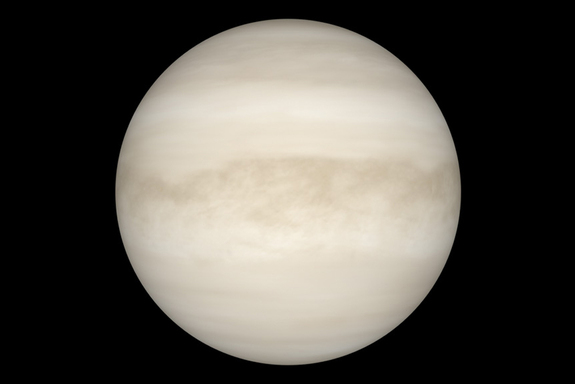 A perspective of Venus with manifest light reveals a smooth, white sphere. The light can't dig a planet's thick cloud layer.