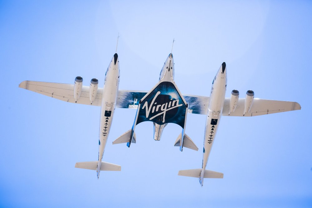 Virgin Galactic's second SpaceShipTwo, the VSS Unity, is seen during its first captive carry test flight with its mothership WhiteKnightTwo at the Mojave Air and Space Port in California on Sept. 8, 2016.