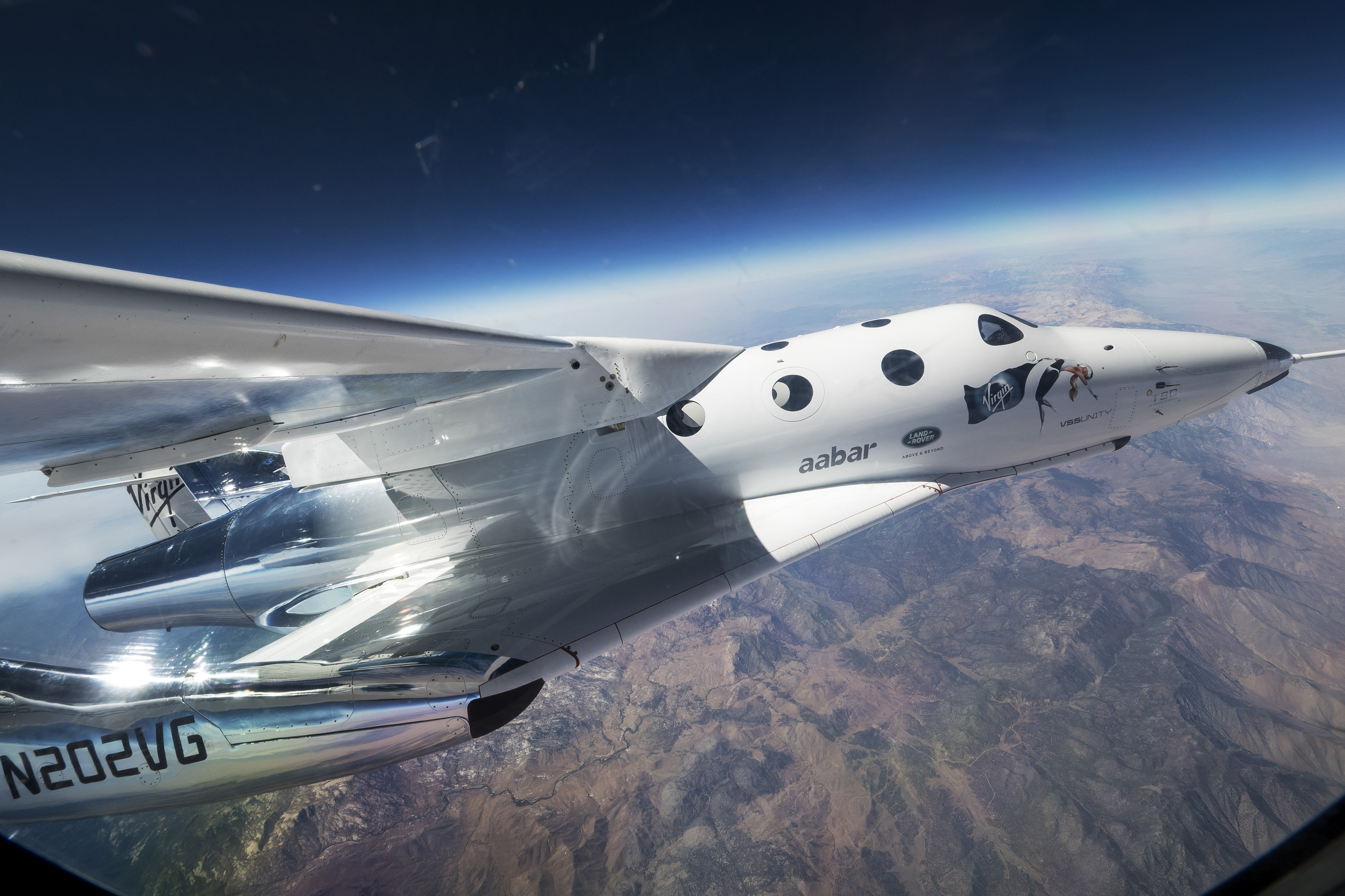 Virgin Galactic's second SpaceShipTwo, the VSS Unity, takes its first flight with its carrier plane Eve as they soar over Mojave, California on Sept. 8, 2016.