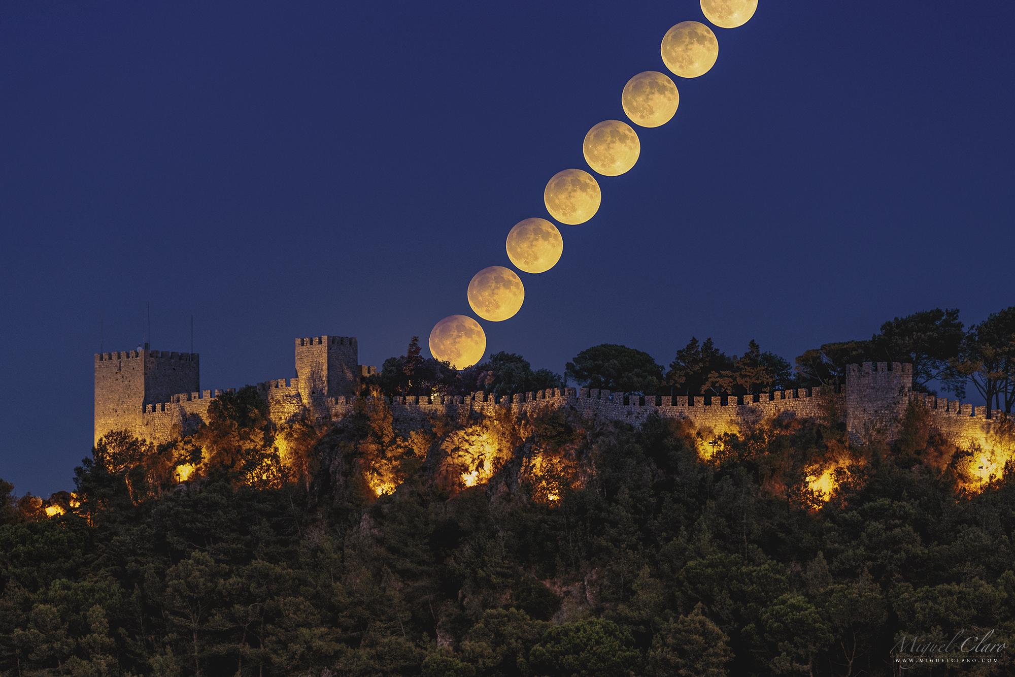 Harvest Moon moonrise over Sesimbra Castle, Portugal