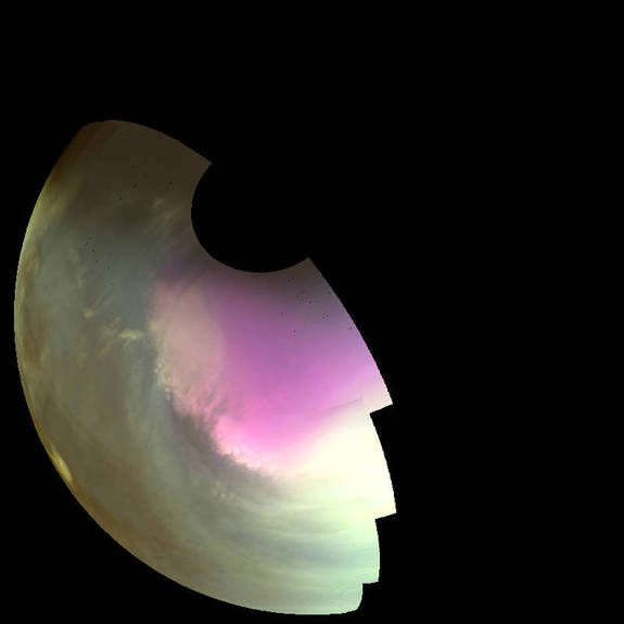 This ultraviolet image near Mars' South Pole was taken by MAVEN on July 10 2016 and shows the atmosphere and surface during southern spring. The ultraviolet colors of the planet have been rendered in false color, to show what we would see with ultraviolet-sensitive eyes. Darker regions show the planet's rocky surface and brighter regions are due to clouds, dust and haze. The white region centered on the pole is frozen carbon dioxide (dry ice) on the surface. Pockets of ice are left inside craters as the polar cap recedes in the spring, giving its edge a rough appearance. High concentrations of atmospheric ozone appear magenta in color, and the wavy edge of the enhanced ozone region highlights wind patterns around the pole.