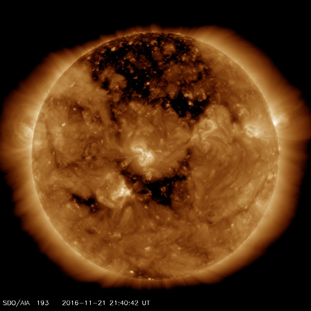 Holes in the Sun! One's Real, the Other Not So Much (Video)
