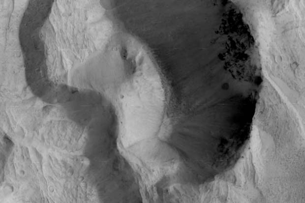 Fly Over Martian Chasms and Craters Through ExoMars Orbiter's Lens | Video