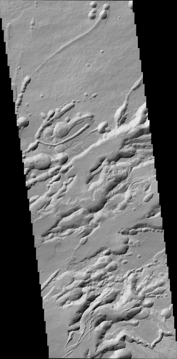 A structure called Arsia Chasmata _n the flanks of _ne of the large Martian volcanoes, Arsia Mons. This view was created by the Colour and Stereo Surface Imaging System (CaSSIS) aboard the European Space Agency's ExoMars Trace Gas Orbiter. The width of the image is around 16 miles (25 kilometers). The formation is volcanic in origin, and pit craters are visible.