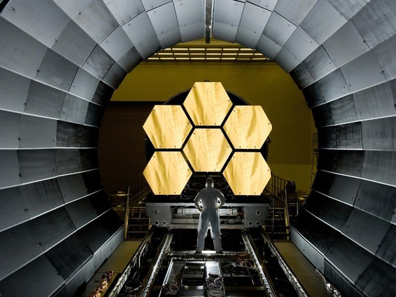The James Webb Space Telescope (pictured here during a mirror inspection) will enhance Hubble's observations in many areas, but it lacks in ultraviolet capabilities.