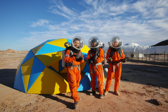 The Martian Space Construction Company: Our Dome Team with tools, Claude-Michel, Jon and Anastasiya.