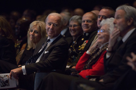 Vice President Joe Biden smiles and looks at Annie Glenn, widow of former astronaut and Senator John Glenn, as Glenn's son David recounts humorous stories about his father.