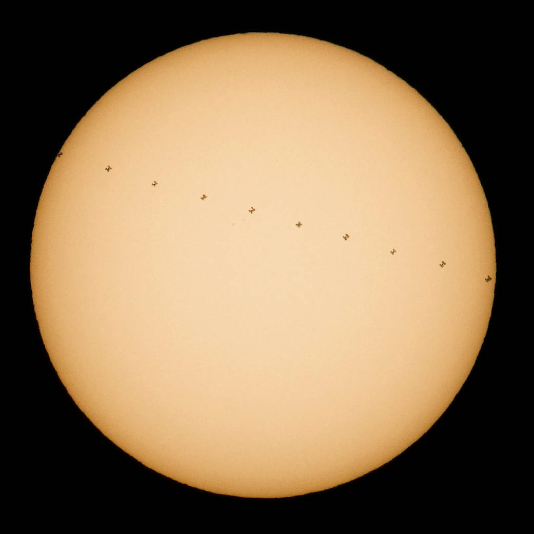 NASA Photographer Sees International Space Station Cross the Sun