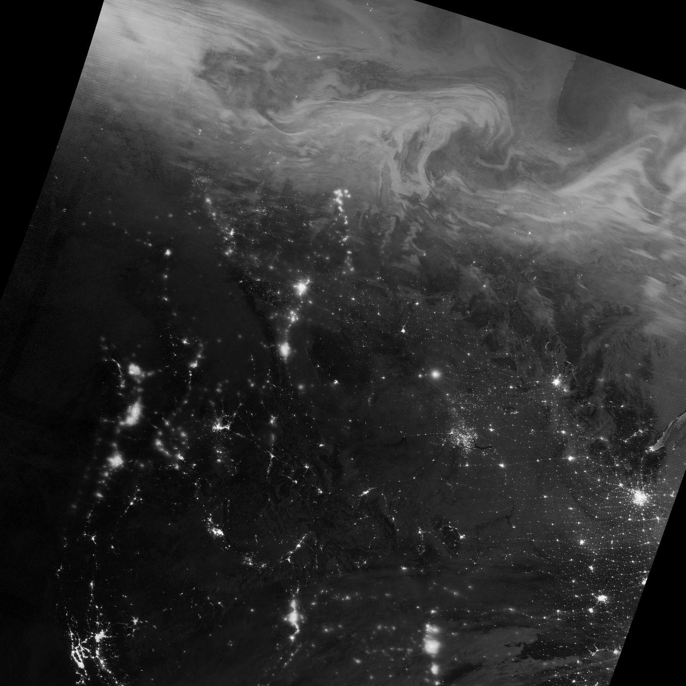 Northern Lights' Festive Show Captured in Stunning NASA Image