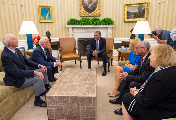 "President Barack Obama meets with Apollo 11 astronauts Michael Collins, seated left, Buzz Aldrin, Carol Armstrong, widow of Apollo 11 commander Neil Armstrong, NASA Administrator Charles Bolden, and Patricia ""Pat"" Falcone, OSTP Associate Director for National Security and International Affairs, far right, Tuesday, July 22, 2014, in the Oval Office of the White House in Washington, during the 45th anniversary week of the Apollo 11 lunar landing."