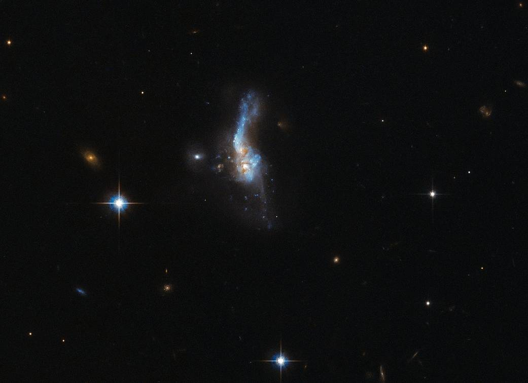 Beautiful Galaxy Collision Captured by Hubble Telescope