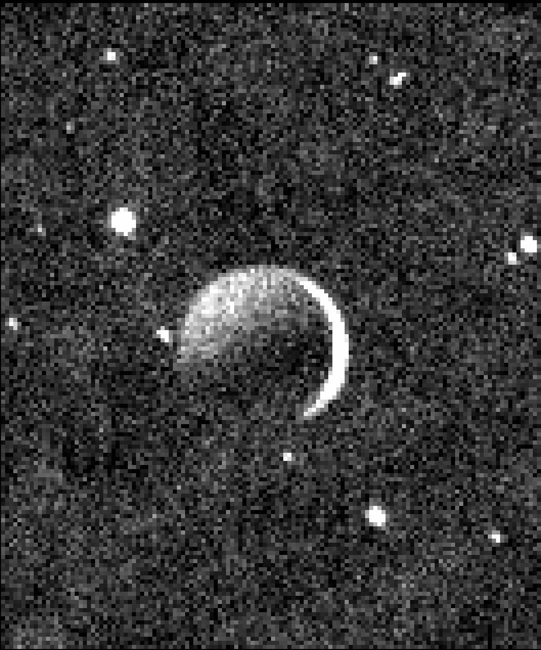 Moonshine Glow: See Pluto's Moon Charon as a Crescent in NASA Photo