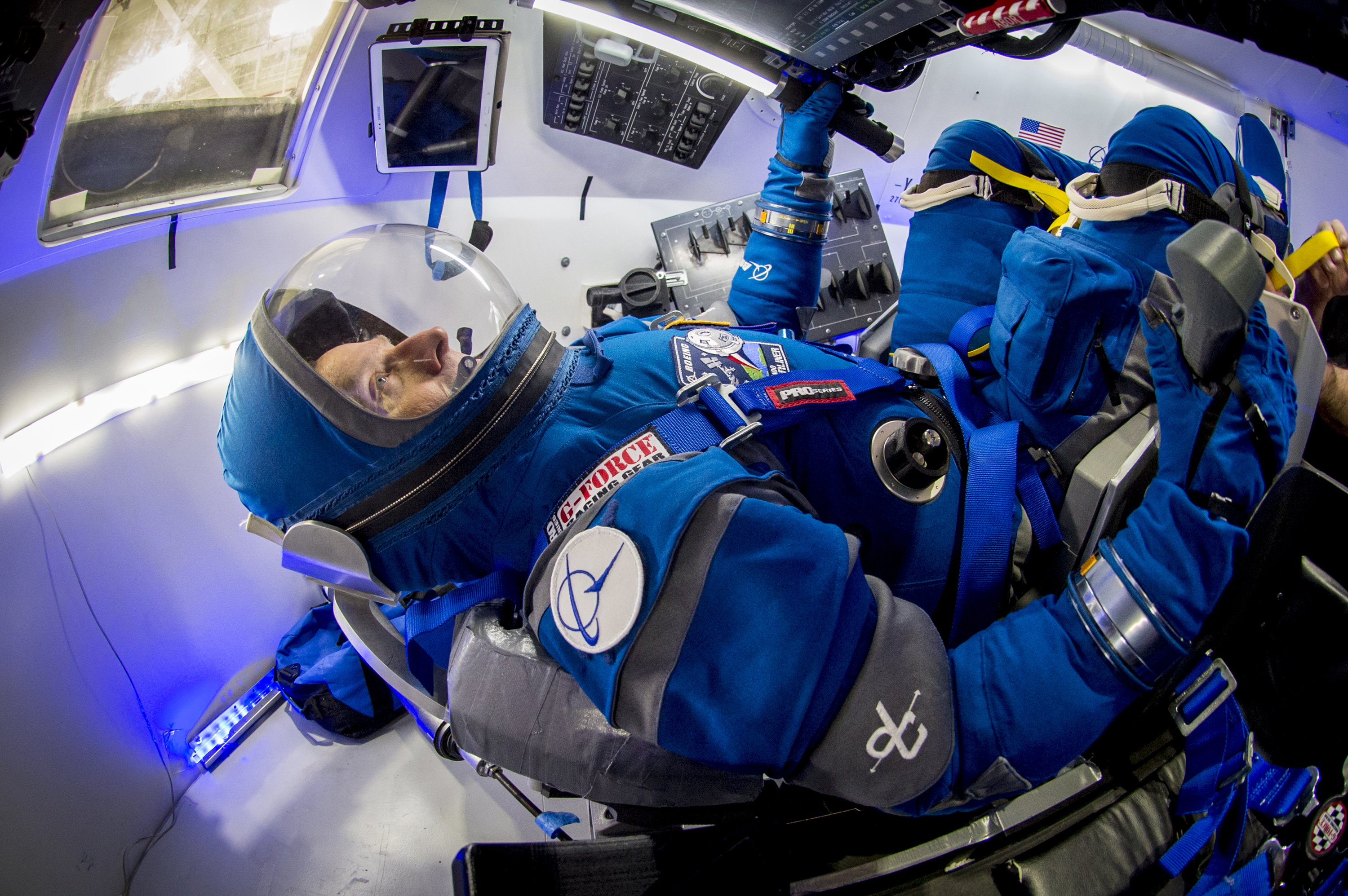 Boeing Unveils New Spacesuits for Starliner Astronaut Taxi ...