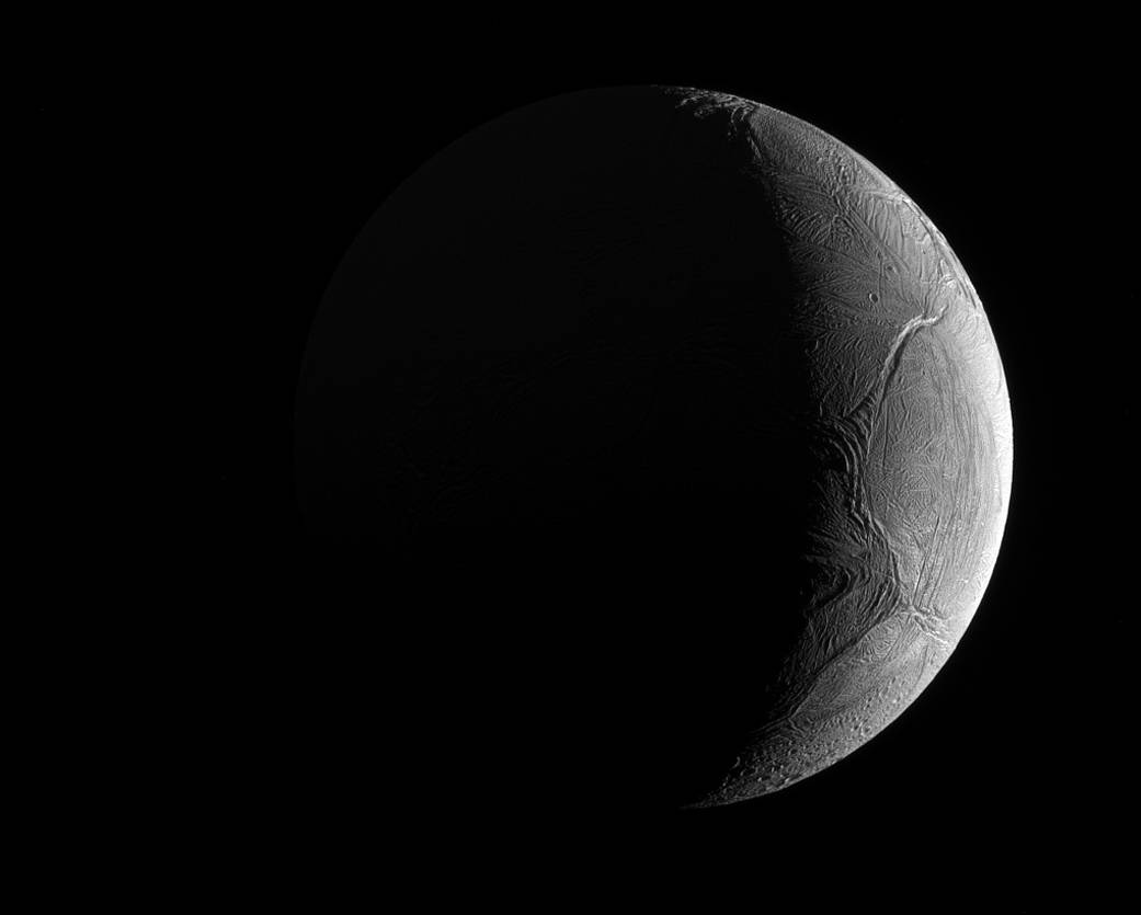 Saturn's Icy Moon Enceladus, a Possible Home for Life, Shines in Photo