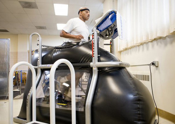 Retired Staff Sgt. Jesse Whitmier exercises in the NASA-developed